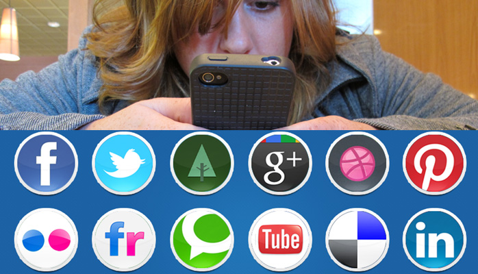 frazzled woman staring in desperation at a mobile phone surrounded by social media icons