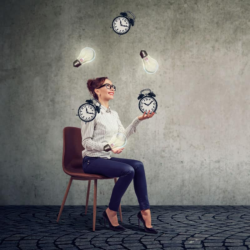 business woman juggling ideas versus time to demonstrate perceived value